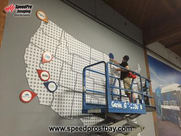 Installing place-marker icons on giant wall map printed by SpeedPro in San Carlos
