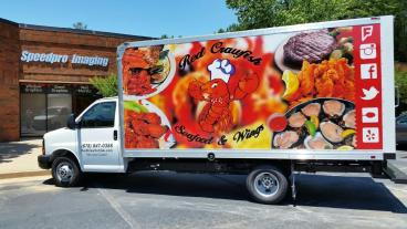 Red Crawfish Seafood and Wings Delivery truck