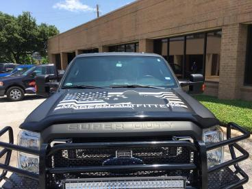 Eye-catching truck wrap by Speedpro Imaging of Dallas on Elmbrook Drive