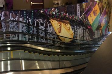 escalator wrap mardi gras casino CO denver flags