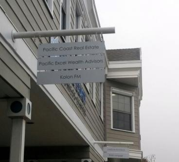 Pacific Coast Real Estate directional sign