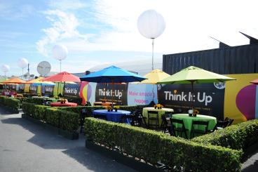 Think It Up Event with banners along the perimeter fencing