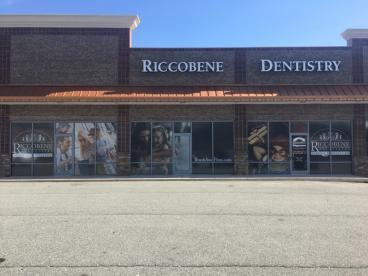Perforated window film for Riccobene Associates Family Dentistry in Mebane, NC.