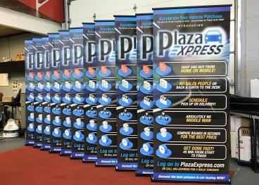11 Banner Stands - Plaza Auto Group