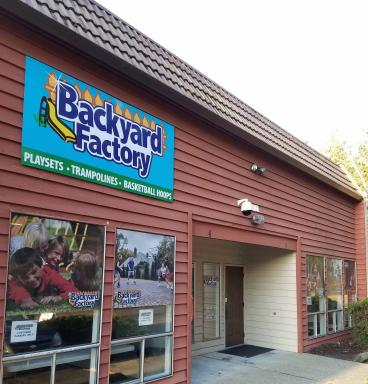 New dibond sign and window graphics at Backyard Factory in Kirkland