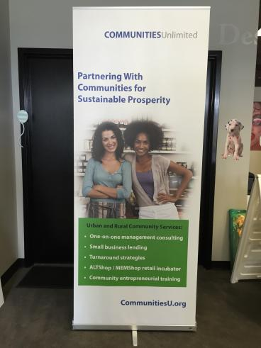Share your message with a retractable banner stand.