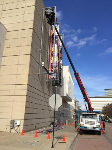 Installing a new banner for the Eisemann Performing Arts Center in Richardson, TX