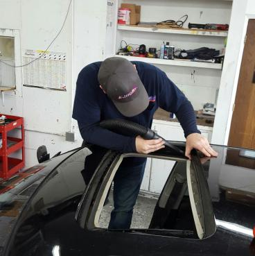 Donny getting ready to install a sunroof. Thumbnail
