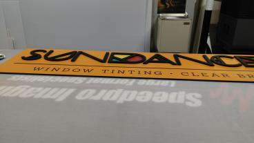 Indoor Signage: Sundance Window Tinting  (Metro Denver)