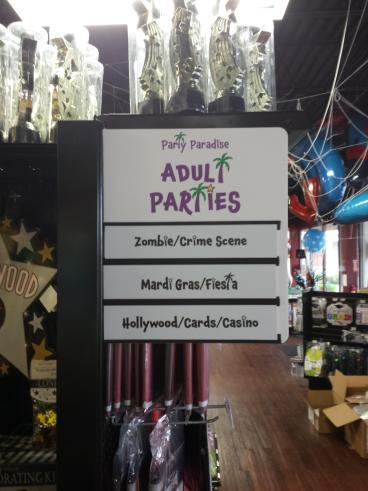 Aisle signs for Party Paradise