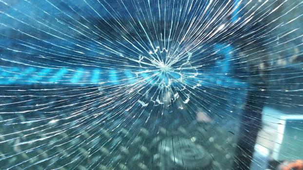 A 2x4 hit this windshield while it was driving on the highway.