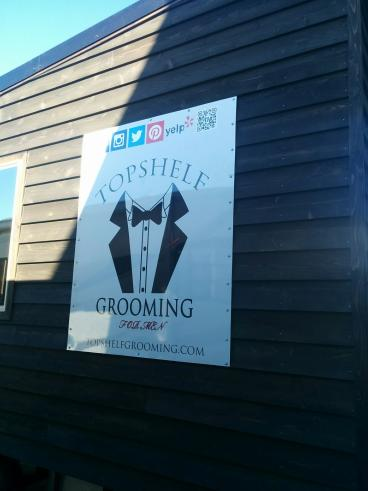 Top Shelf Grooming trailer sign on aluminum