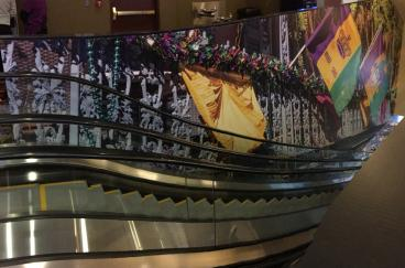 escalator wrap mardi gras casino CO denver flags