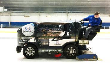 Watch out! There is a golf cart on the ice!