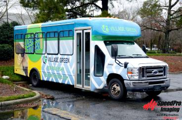 Village Green gets Full Wrap on Shuttle Bus