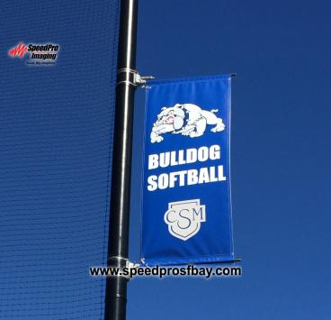 Pole banner at sports stadium