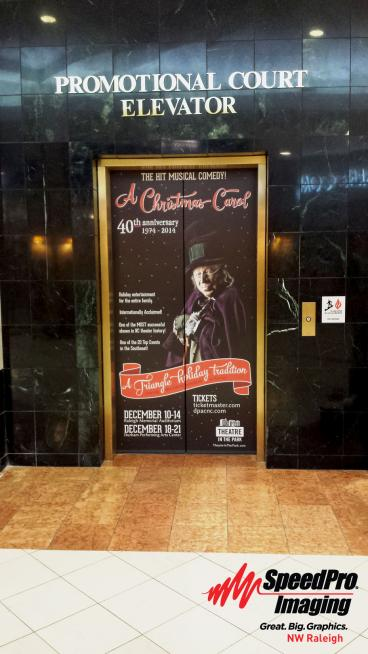 Promotional Court at Crabtree Valley Mall gets Seasonal Elevator Graphics