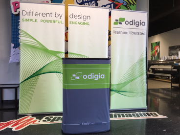 Tradeshow graphics featuring a branded Podium and Banner Stand Wall