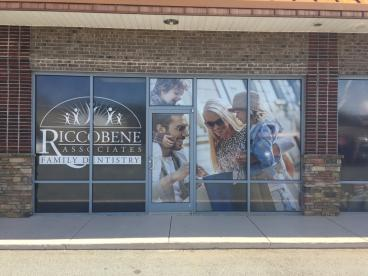 Perforated window film for Riccobene Associates Family Dentistry in Mebane, NC.