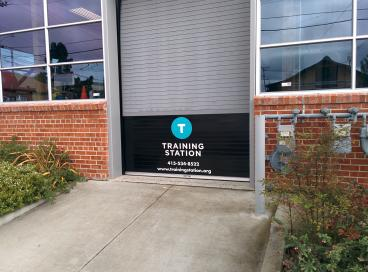 Pull up door decal for Training Station Alameda