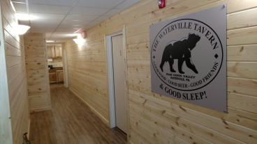 Waterville Tavern Wall Mount Logo at entrance to guest rooms