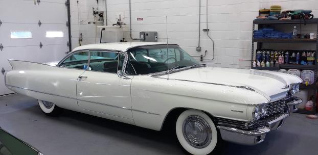 This 1960 Cadillac Sedan DeVille shares a garage with a car we repaired.