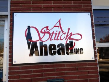 A Stitch Ahead New Jersey Outdoor Acrylic Lettering Sign