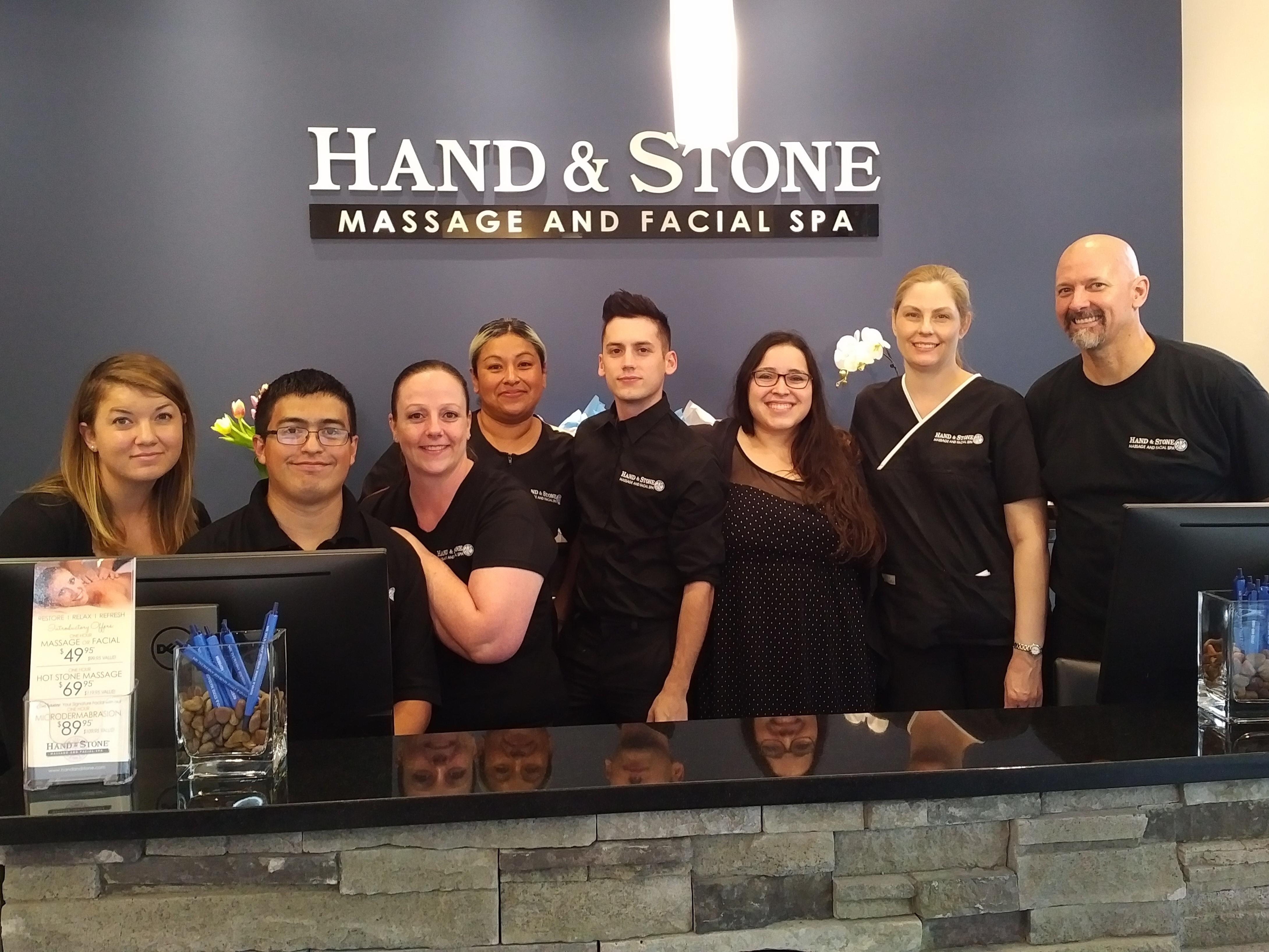 A few of Hand & Stone Team members ready to serve you.