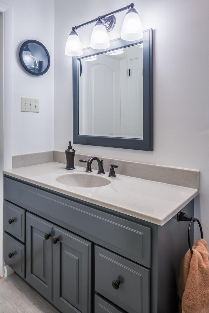 After - new vanity, framed mirror and lights