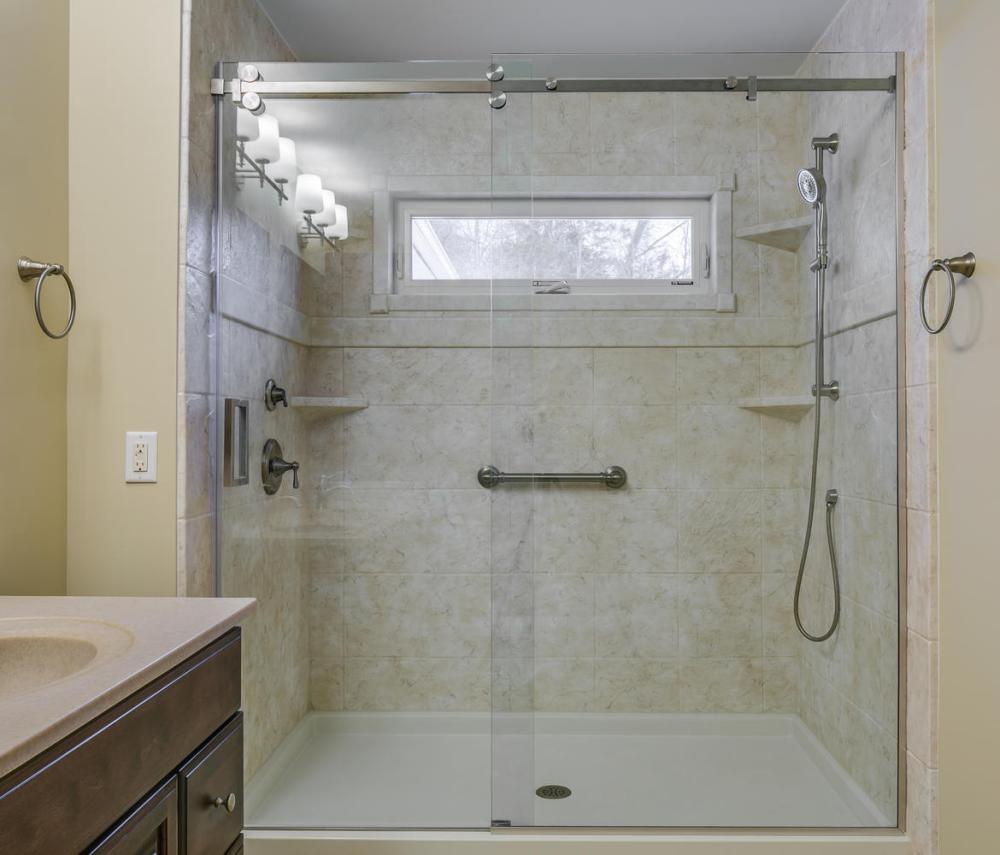 After - new DuraBath SSP shower with hand shower and grab bar