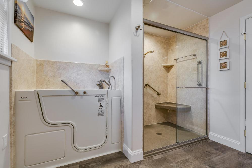 After - expanded the bathroom to make room for a walk in tub and a separate shower