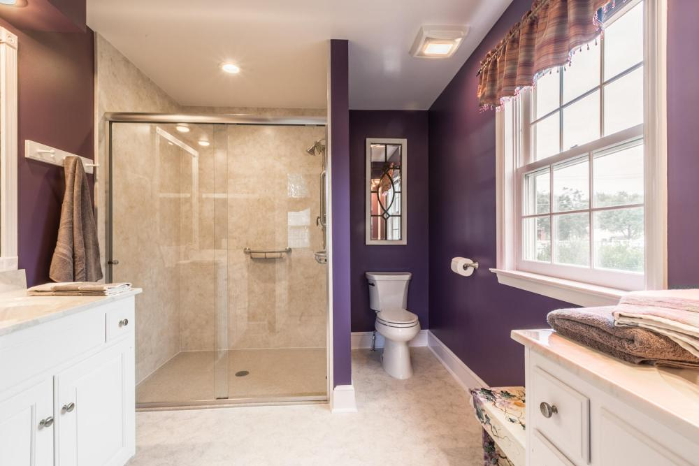 Removing the large soaking tub and small shower created space for a larger shower and the relocation of the toilet.  This layout game the homeowner a spacious shower with a low threshold and opened up floor space by putting the toilet in a location that made a lot more sense.