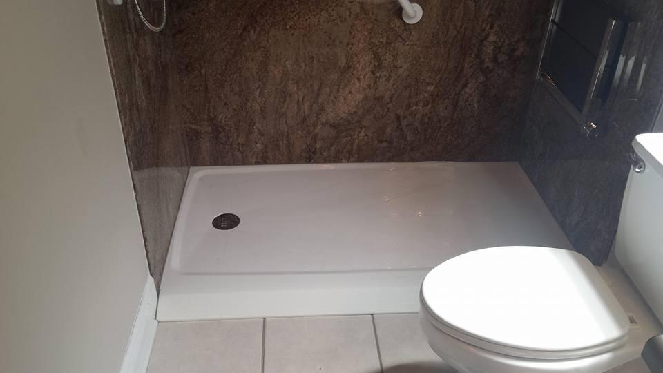Barrier Free shower pan with fold down seat that replaced a bath tub. This walk in shower is VA approved for handicapped or disabled veterans.  Shower also has grab bars and fold down shower seat.  Installed near Midland City, AL.