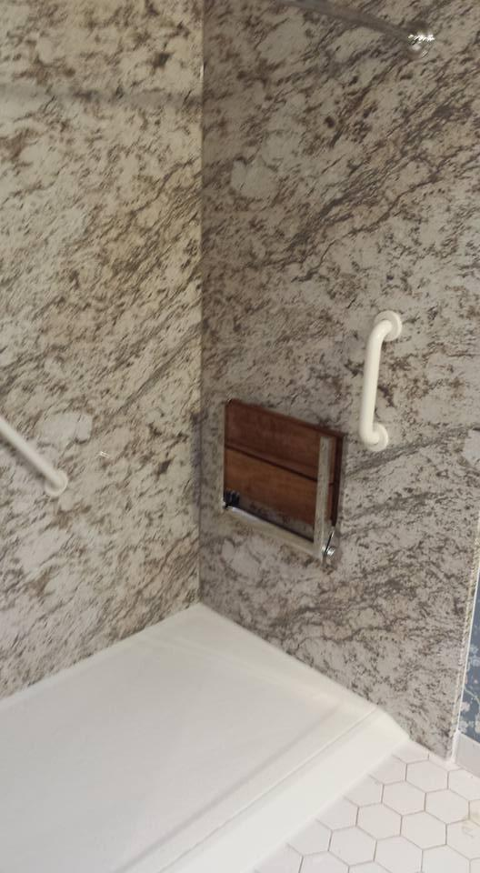 This tub to shower conversion is handicap accessible with a ramp and fold down shower seat.