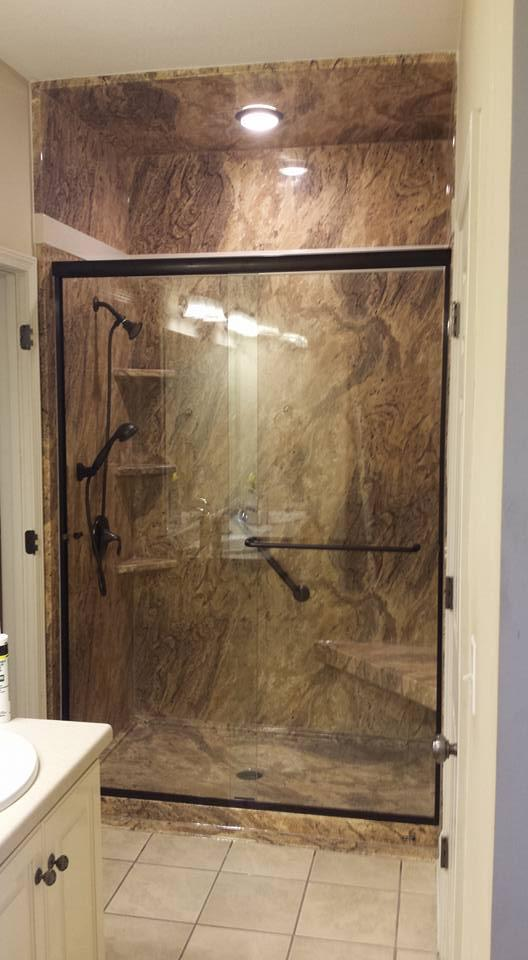 This shower has been remodeled in the Adara Granite color and features a matching shower pan and corner seat.