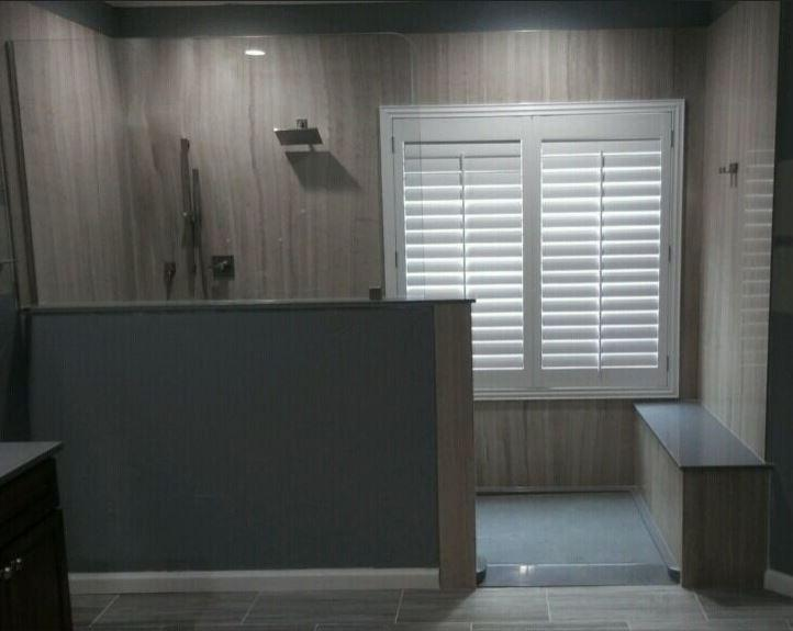 Open concept Shower with Durabath Natural Stone Walls and Waterproof Plantation Shutters