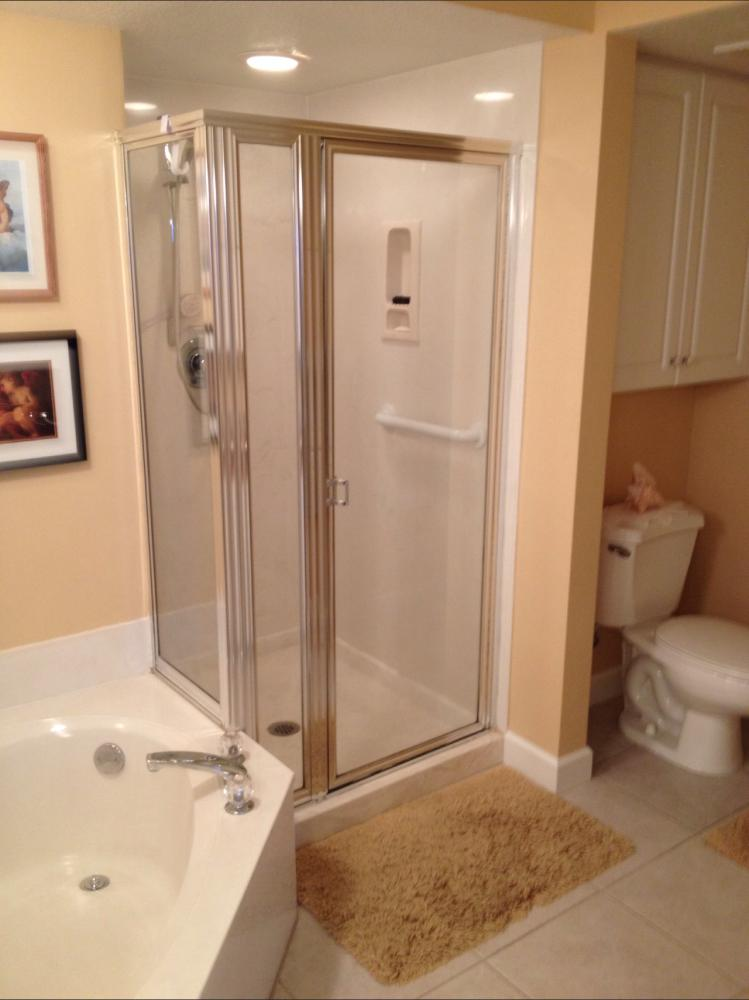 Our client needed to update their shower and glass. They had moldy grout and an outdated glass enclosure.