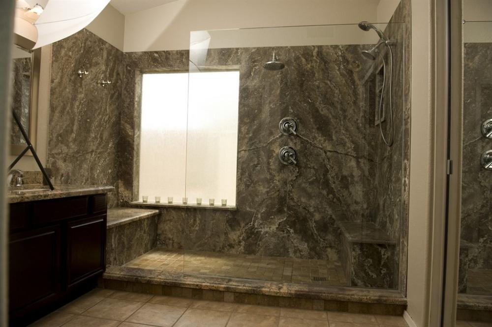 Light Emperador Marble Shower with Custom Dual Seating and Mutliple Shower Heads