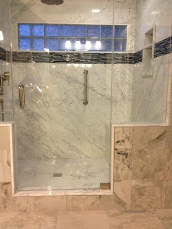 White Cararra Marble Shower with Deco Tile and Custom Glass