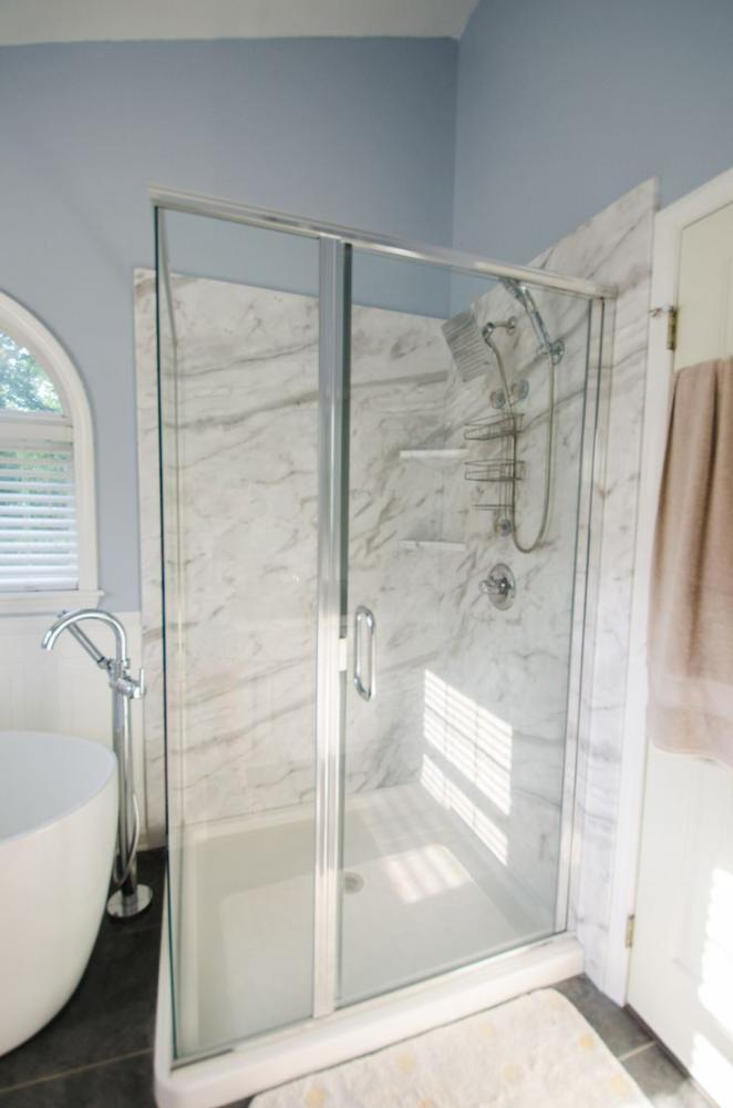 White Cararra Marble Corner Shower with Custom Glass
