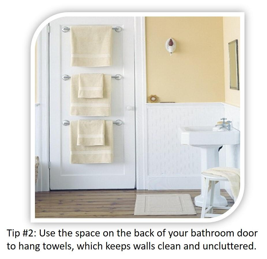 Small Bathroom Tip #2: Use the space on the back of your bathroom door to hang towels.