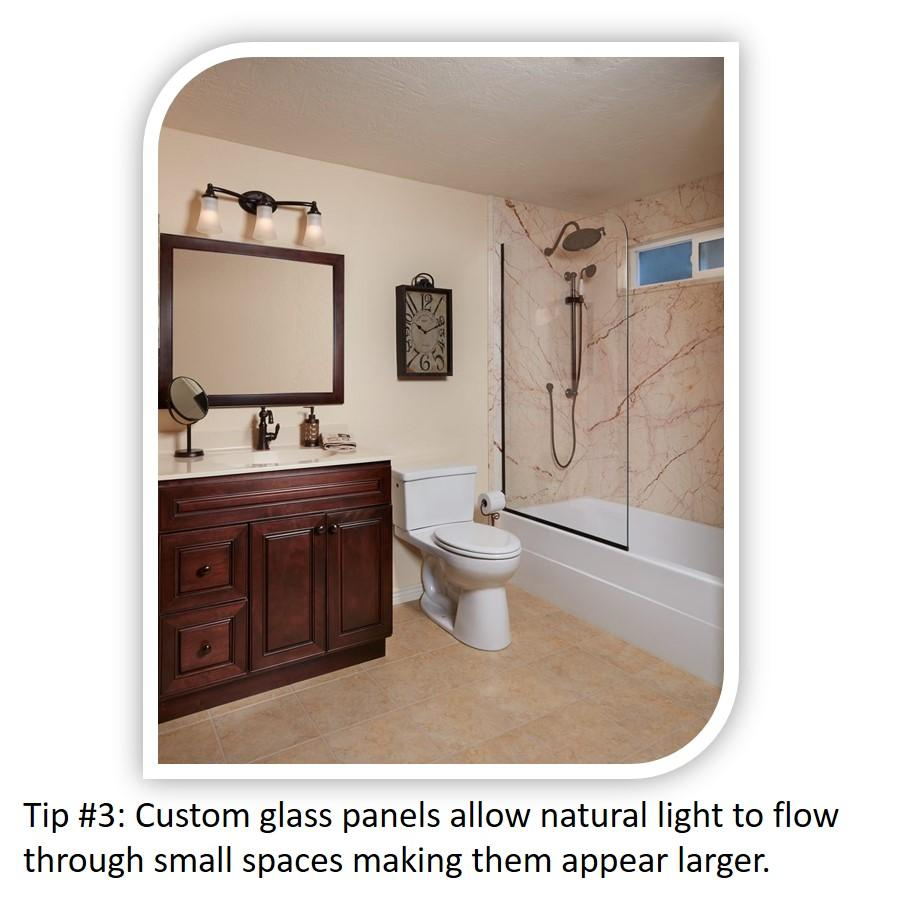 Small Bathroom Tip#3: Custom shower glass panels allow natural light to flow through a small space.