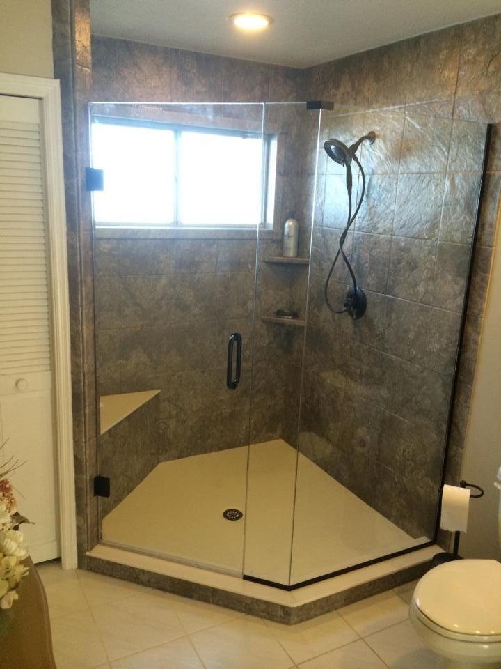 Solid Surface Corner Shower with Custom Bench and Handheld Shower Head