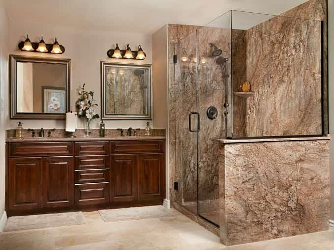 Custom Solid Surface Shower in Tahoe Granite with Complimentary Vanity, Mirrors and Lighting.