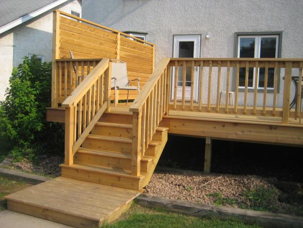 Cedar deck with privacy wall in Highland Park