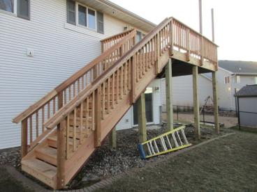 Cedar deck re-build - replaced 3 support posts and added stair posts for stabilization in Eagan