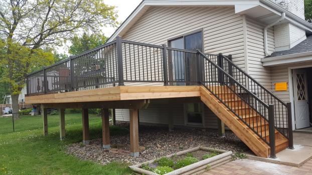 Doubled the size of the old deck with cedar materials and aluminum railing in Bloomington