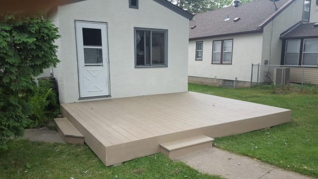 Removed old concrete stoop and built ground level Deckorator composite deck