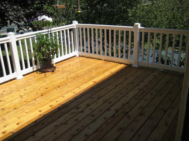 Replaced old decking with new cedar and vinyl railings in Burnsville