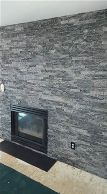 Stone tile wall installed After- Westminster. CO